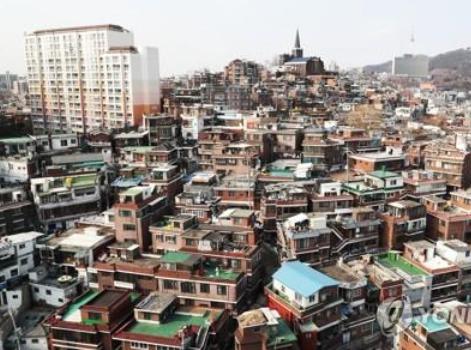 韩国综合开发的消息说龙山区的交易住宅的33%是外地人