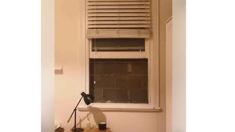 """墨尔本房客猛烈抨击""""非法""""墙只阻挡窗户"""